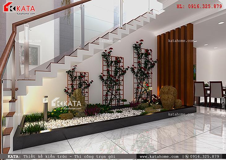 Khu tiểu cảnh xinh đẹp được bố trí ở chân cầu thang của mẫu thiết kế nhà phố 4 tầng đẹp hiện đại