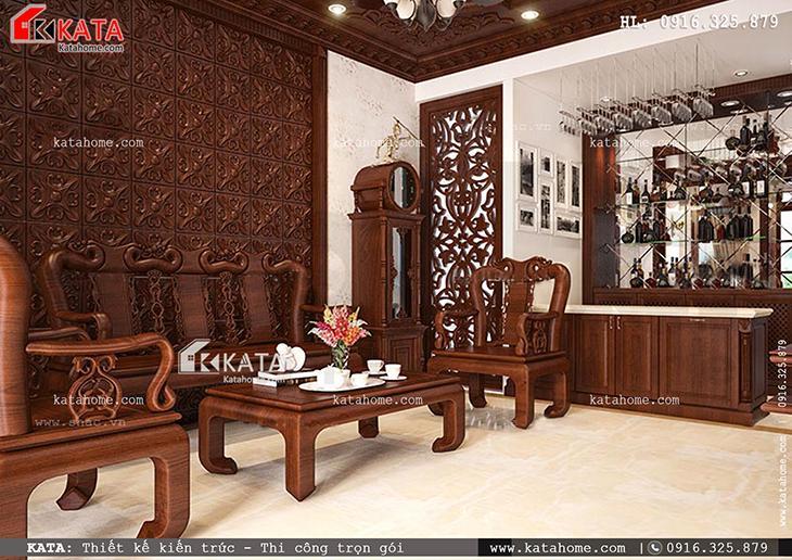 Thiết kế nhà phố 4 tầng với nội thất gỗ phòng khách đẹp và ấn tượng với bức vách ốp tường gỗ với hoa văn nổi