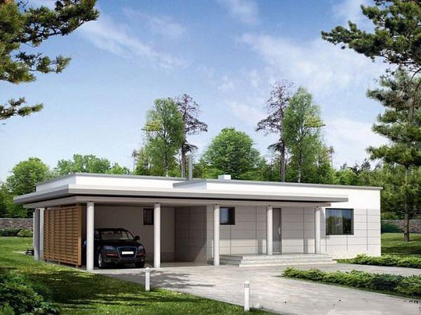 Mẫu nhà cấp 4 phong cách châu Âu với mái bằng, cửa sổ kính và sơn tường bên ngoài màu trắng sang trọng. Chủ nhân dành một phần diện tích bên hông nhà làm nơi để ô tô.
