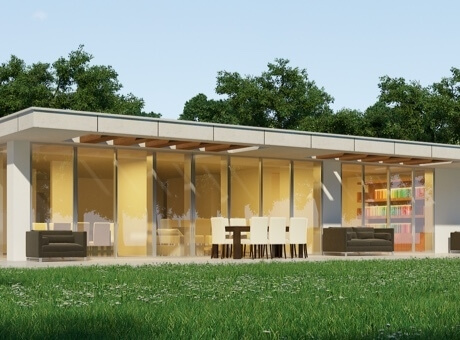 Hình ảnh phối cảnh mẫu nhà 1 tầng mái bằng hiện đại vùng ngoại ô với tường kính trong suốt nhìn ra sân vườn xanh mát